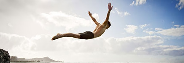 image of a man jumping on the air