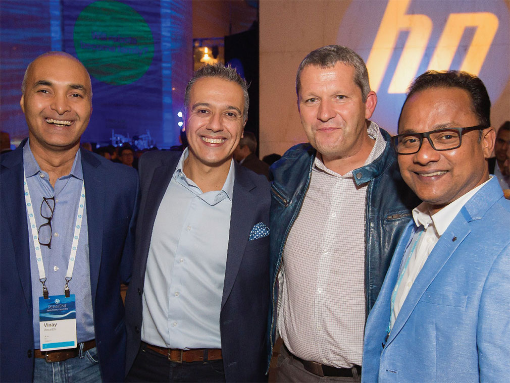 Image of Nick Lazaridis, President, EMEA Region and Christoph Schell, President, Americas Region and two attendees at Reinvent World Partner Forum 2017