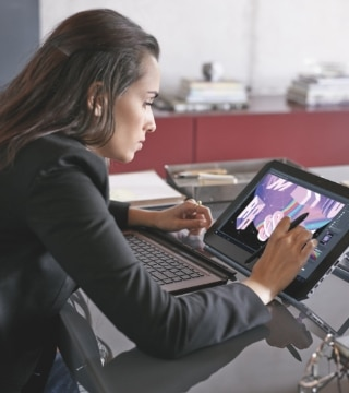 Lady using HP laptop in tablet mode