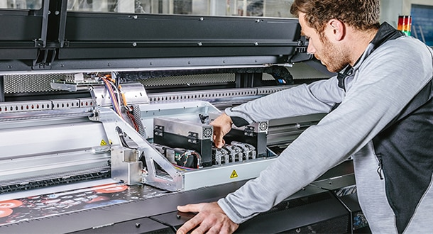 Technician inspecting interior of HP Latex printer