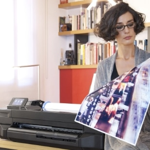 Woman printing an illustration with the HP Designjet T120 printer