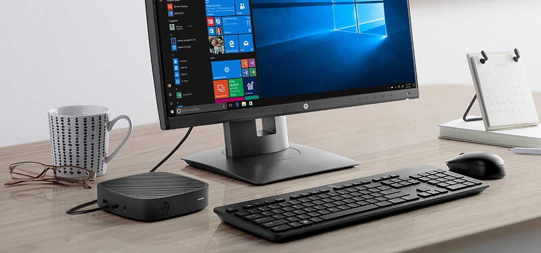 HP t430 thin client on desk with monitor and keyboard