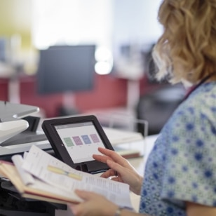 Woman working in healthcare using HP products