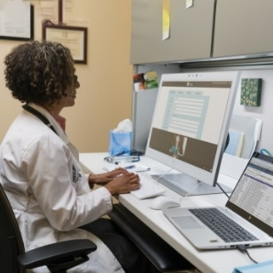 Doctor in back office using an HP Healthcare Edition products