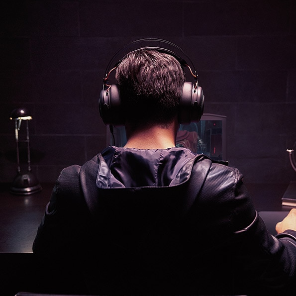 Young person using headphones on his desk