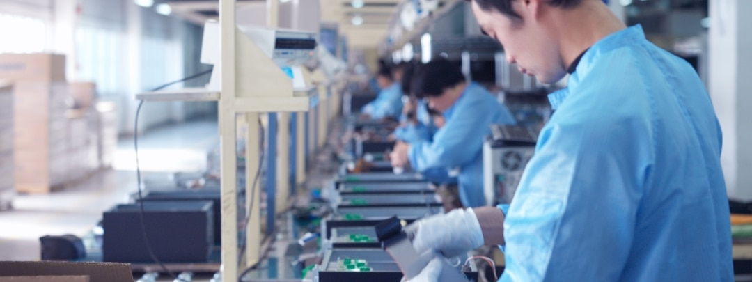 man working by the assembly line