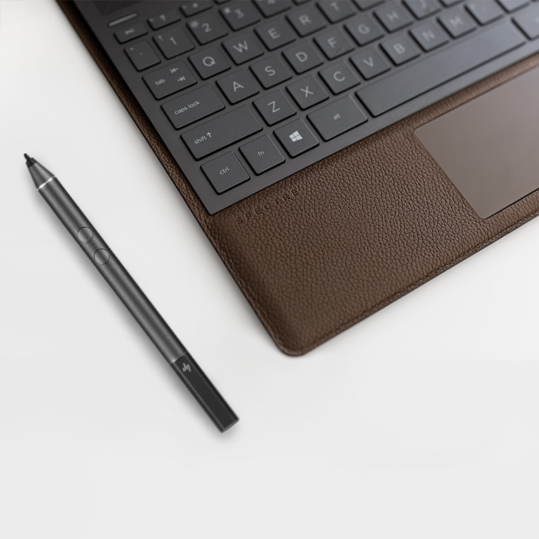Spectre folio leather palm rest and keyboard seen sitting open on a table