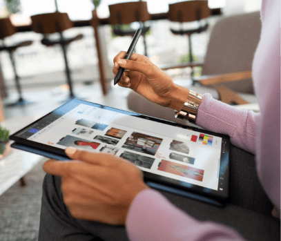 woman using elite x360 PC in tablet mode with active inking pen in open business environment