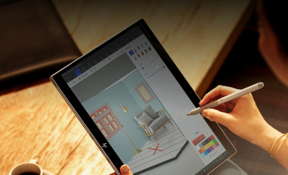 designer using active pen to draw on elite x2 in tablet mode