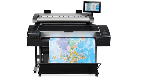Front view of the HP DesignJet HD Pro Multifunction Printer with maps drawing output