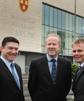 3 business men in front of Institute of Technology CARLOW