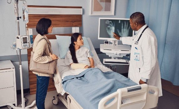 Patient in a hospital with a doctor using HP Healtcare Edition products