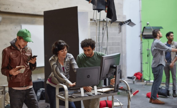 A group of creative professional using a HP Z products to work on a video project.