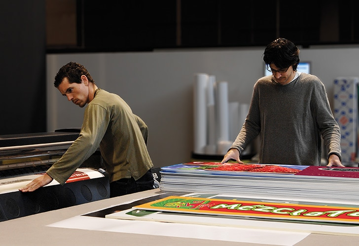 Two persons using a large format printing