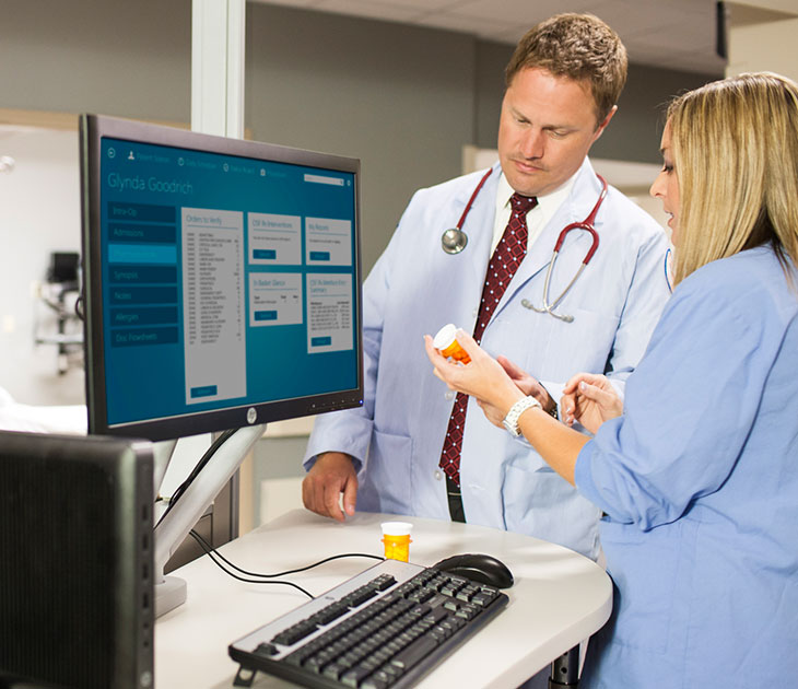 Medical staff using HP desktop for prescriptions