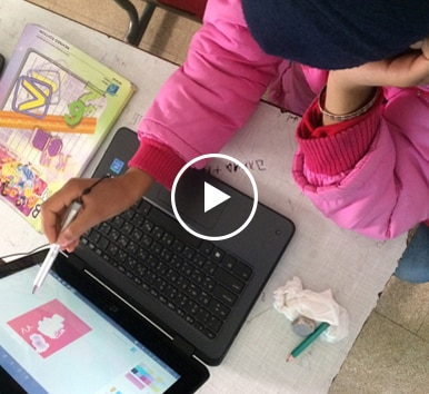 Image of the Syrian refugee student in Lebanon using HP PC