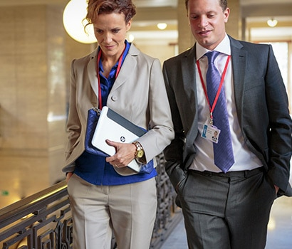 Image of business woman and man walking in a building