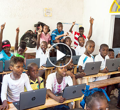 Image of Haiti students in classroom with HP laptops