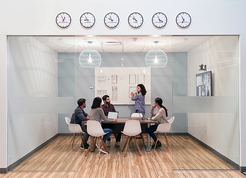 Five business people collaborating in a conference room