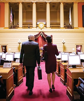 Man and woman in senate chambers