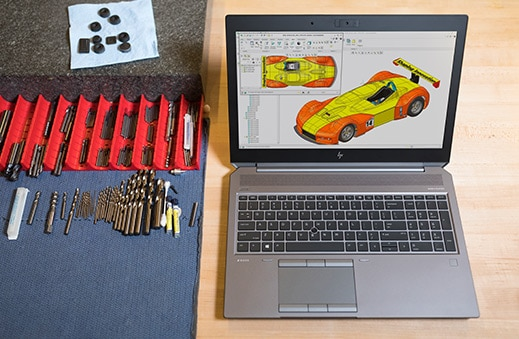 Zbook 15 laptop workstation open with product design imagery on screen.