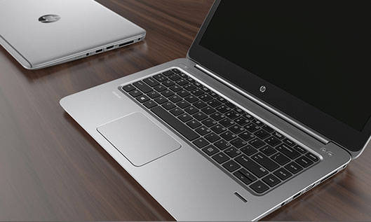 dos hp elitebooks sobre la mesa