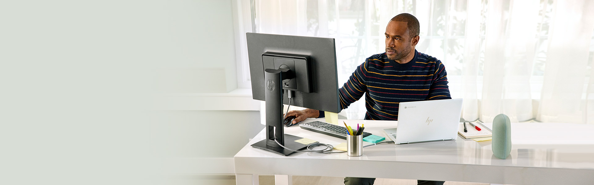 Man working on HP Chromebook at desk